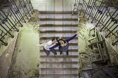 Friends in broken stairs. Aggressive women shouting, madness and rage Stock Photo
