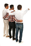 Friends business men pointing background. United friends of business men standing in embrace and pointing to white space in background Stock Photography