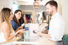 Friends buying jewelry with credit card Royalty Free Stock Image
