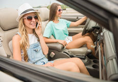 Friends in cabriolet Stock Image