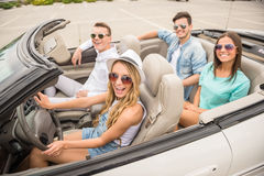 Friends in cabriolet Royalty Free Stock Photos