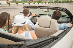 Friends in cabriolet Stock Images