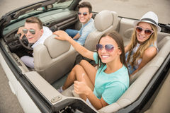 Friends in cabriolet Stock Photos