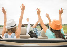 Friends in cabriolet Royalty Free Stock Photography