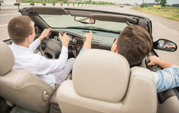 Friends in cabriolet Royalty Free Stock Image