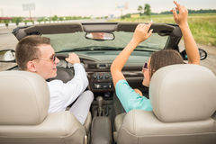 Friends in cabriolet Royalty Free Stock Photo