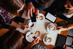 Friends In Cafe Drinking Coffee Stock Images