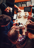 Friends In Cafe Drinking Coffee Stock Photography