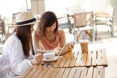 Friends in cafe Stock Photography