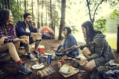 Friends Camping Eating Food Concept. Friends Camping Eating Food Outdoors royalty free stock photo