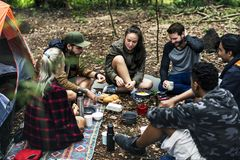 Friends camping in the forest together Royalty Free Stock Photos