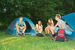 Friends on camping Stock Images