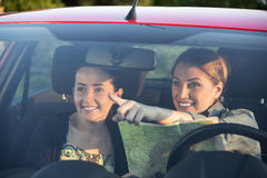 Friends in car enjoy road trip Stock Images