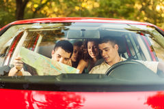 Friends in car going on picnic Stock Image