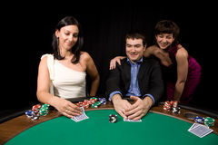 Friends in casino. Company of friends having fun in the Vegas casino royalty free stock image