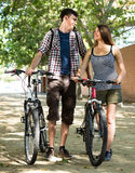 Friends in casual clothes cycling Royalty Free Stock Photography