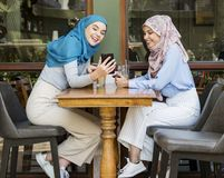 Friends catching up after working. Hours at cafe royalty free stock photography