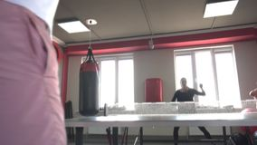 Friends caucasian man and beautiful pretty girl play table tennis in a modern gym, slow motion, lifestyle, healthy stock footage