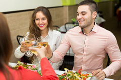 Friends celebrates holiday in restaurant Stock Images