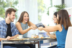 Friends celebrating birthday and giving gift Royalty Free Stock Photos