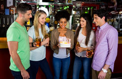 Friends celebrating with cake Stock Image