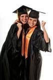 Friends celebrating graduation. Girls celebrating their graduation very happy stock images