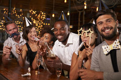 Friends celebrating New Year�s Eve at a party in a bar stock photo