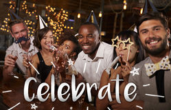Friends celebrating New Year�s Eve at a party in a bar royalty free stock images