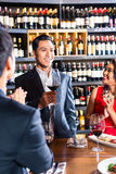 Friends celebrating in restaurant Royalty Free Stock Photo