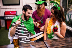 Friends celebrating St Patricks day. With cocktails Stock Image