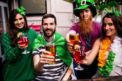 Friends celebrating St Patricks day. With drinks in a bar Stock Photography