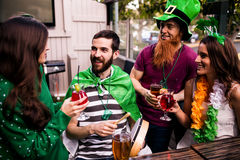 Friends celebrating St Patricks day. With drinks in a bar Stock Photo