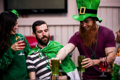 Friends celebrating St Patricks day. With drinks in a bar Royalty Free Stock Images
