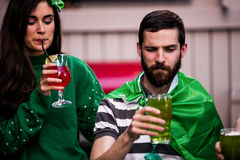Friends celebrating St Patricks day. With drinks in a bar Royalty Free Stock Photos
