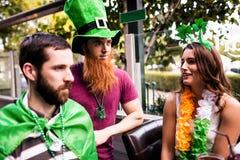 Friends celebrating St Patricks day. Outside Stock Photography
