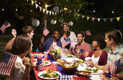 Friends Celebrating 4th Of July Holiday With Backyard Party royalty free stock photo