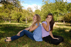 Friends with cellphones. Two teenage girls with cell phones having fun outdoors Royalty Free Stock Photo