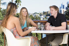 Friends chatting on the balcony. Drinking tea and coffee stock photos