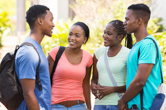 Friends chatting outdoors. Group african college friends chatting outdoors royalty free stock photos