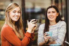 Friends chatting over coffee. In cafe Royalty Free Stock Photo
