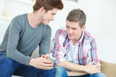 Friends chatting in sitting room. Friends stock photography