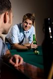 Friends chatting at snooker table Stock Photo