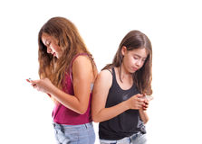 Friends chatting and texting on their phones Stock Images