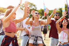 Friends cheering a performance at a music festival Stock Images
