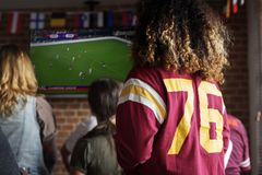 Friends cheering sport at bar together stock images