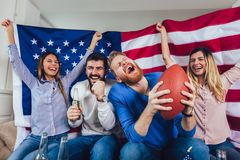 Friends cheering sport league together. At home royalty free stock photo