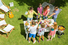 Friends cheering up during party. Friends cheering up during garden party, bird view Royalty Free Stock Photos