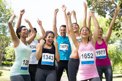 Friends cheering after winning a race Royalty Free Stock Photography