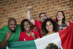 Friends cheering world cup with painted flag royalty free stock image