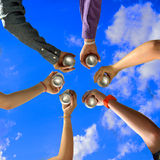 Friends Cheers at Summer Party. Six Friends Cheers with Beer Cans at Summer Party Stock Image
